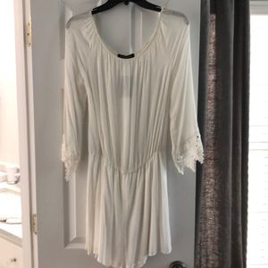 Ivory romper with lace sleeve detailing